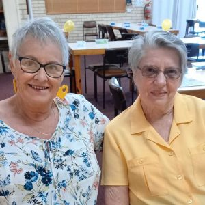 QCWA members Yvonne and Judy. The QCWA is hosting a high tea at Cathy House on October 12
